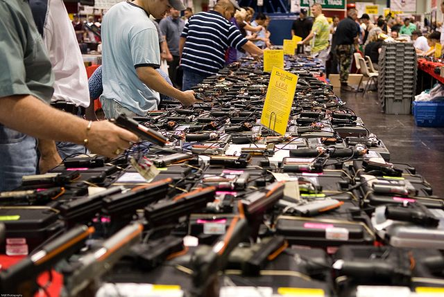 Dozens of handguns at a gun show.